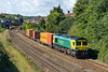 48th Aug 2015:  In Powerhaul livery and now branded 'Genesee & Wyoming Company' 66418 heads away from Parson Street with 4L32 to Southampton.  The question is 'now that the track under the Dundas Aquaduct at Claverton is lowered will this train in future run to Southampton via Westbury and Salisbur?'