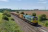 2nd Aug 2015:  At Berkley 66599 passes with hopprs from the HOBC.   6A72 is running from Fairwater Yard in Taunton to Westbury Virtual Quarry where the last half dozen empties will be refilled