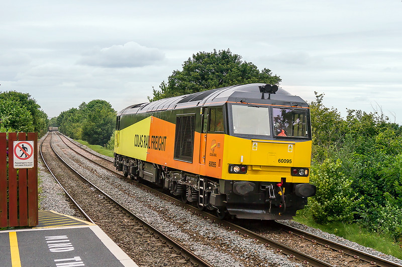 5th Aug 2015:  My guess that 60095 would return to Eastleigh on the evening departmental was correct however unfortunately Victor 31 had no load.  No sun either.  The company 'Safety Helmet' logo has changed !