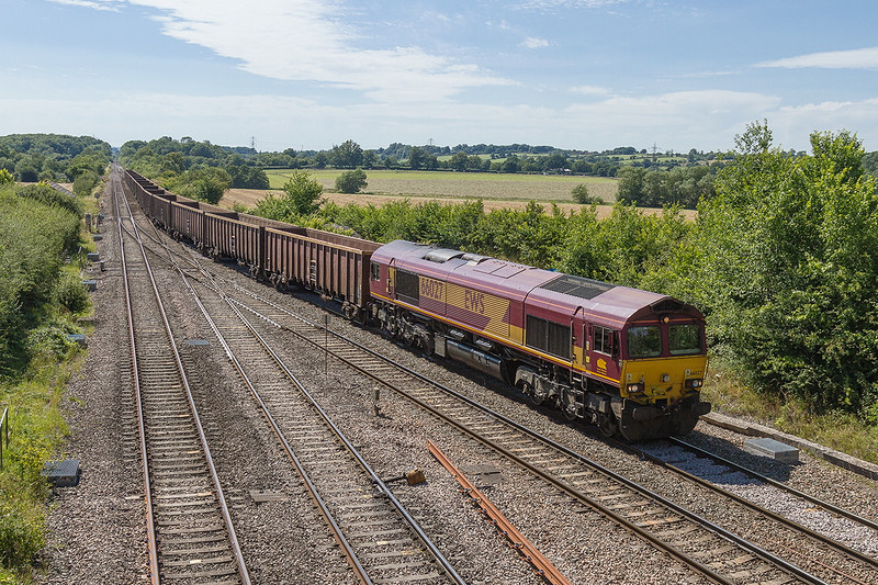 2nd Aug2015:  With 19 empty boxes in tow  66027 takes the station line at Fairwood Junction.  6Z27  had started from Exeter Riverside