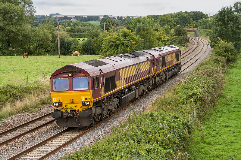 29th Aug 2015:  Although the weather was uninspiring the opportunity of picturing the Saturday convoy on the B & H was not to be missed.  Sad man that I am!  0X12 from Margam to Eastleigh is usually routed via the Avon Valley but due to endineering works in Bath there was a change of plan.  It went via  Gloucester, Swindon.Reading, Newbury and Westbury to regain the usual route via Salisbury.   Shame it was only 66168 & 661626 though, it can run up to 10 locos