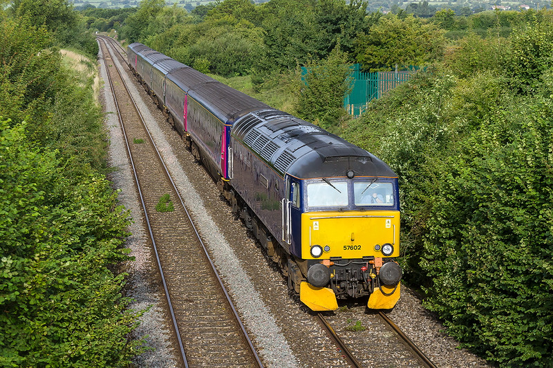 29th Aug 2015: Working up the Westbury 'Cut Off' is 57602 om 5A40 the Exeter to Old Oak Commen empty stoack.  The previous nights train was 'Pined' at Exeter due to Industrial Action.  Careful observation shows that sleeper coaches 3,4,5 & 7 are now in the utterly appauling new Great Western livery.  Sums up the company really.
