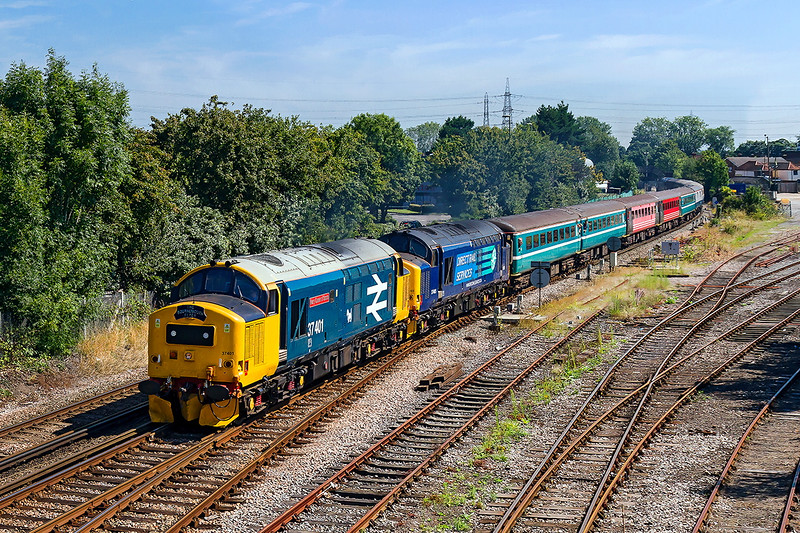 22nd August 2015:  Passing the old yard at Totton is the Chester to Bournemouth 'The Bournemouth Flyer'. 1Z37 is lead by 37401 & 37405 with 57307 at the rear.  Sure sounded good.