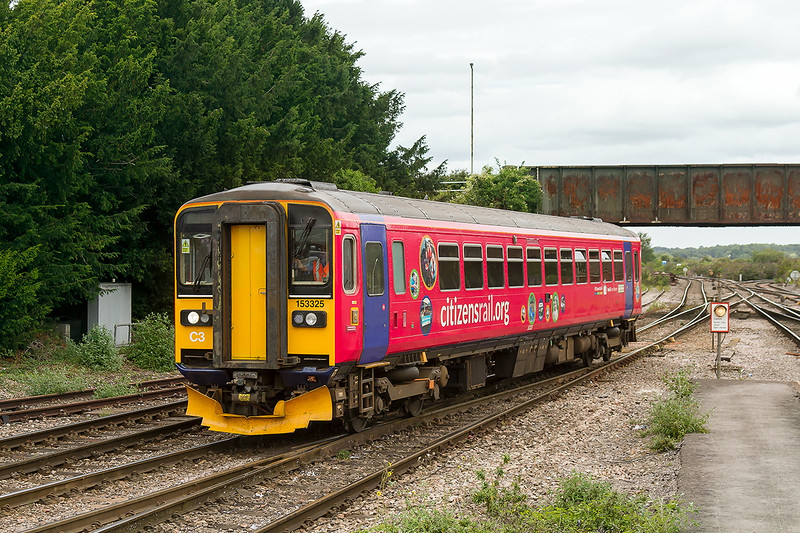 5th Aug 2015:  153325 now in the 'Citizensrail.org' livery moves towards the stabling sidings at Westbury