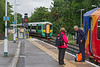 26th Aug 2015:  With the rain now abaited 377315 moves from the Down Siding to Platform 3 as the driver of 455321 has the unenviable task of explaining to the lady that his and therefore her train to Guildford is abhorted due to a fallen tree blocking the line near Ashstead