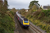 28th Dec 2015:  Diverted due tio the electrification Works on the GWML 1C78 from Paddington to Plymouth started from Waterloo at 08.07.  At 10.38 it is pictured racing therough the site of Somerton Station