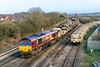 20th Dec 2015:  66004 arriving  at Westbury exactly on time (11.12) with 6W97 the 09.00 from Worcester Hererford Sidings to Westbury long welded rail train.  66087 is at the rear.  The little bit of sun was a real bonus.