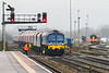 15th Dec 2015:  During a crew change at Westbury 59004 stands at the foot crossing with 7B12 from Merehead to Wootton Bassett