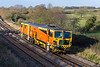 4th Dec 2015:  Colas Tamper DR 73805 hurries through Great Cheverell as it works rgw 07.52 from Tavistock Junction Plant Depot to Slough Estates