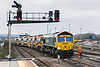 17th Dec 2015:  Returning to Westbury for a refill are 66614 & 66527 and 2 sets of Autoballasters.  Line is being relaid between Weymouth and Dorchester and this train started from Dorchester South at 05.33.  The shunter is giving the driver a telephone so that he can guide the driver as he pushes the train back into the quarry sidings
