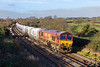 4th Dec 2015:  66107 on the point of 6M20 from Whatley to St Pancrad Churghyard Sidings storms through Great Cheverell on a welcone sunny morning