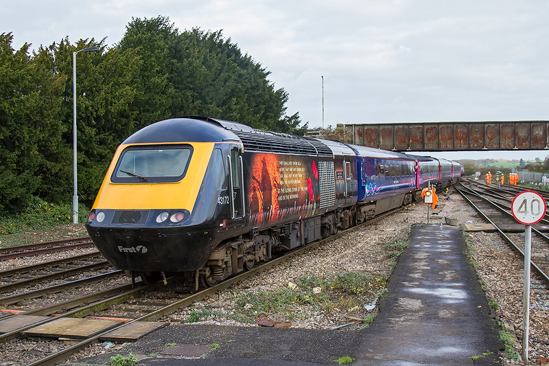 1st Dec 2015:  43172 with the memorial to the fallen in War 1A78 the 06.45 Penzance to Paddington departs from Westbury.  With 43041 on the front it is passing a gang who were tamping the point work.  In total I counted a total of 19 workers, most were behind the train.
