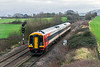 16th Dec 2015:  On Monday 14th December South West Trains launched a new service between Waterloo and Yeovil Pen Mill that runs via Salisbury calling at Warminster, Westbury, Frome, Bruton  & Castle Cary. 3 days in and 159014 is captured at Fairwood working 1L35 the 12.50 from Waterloo