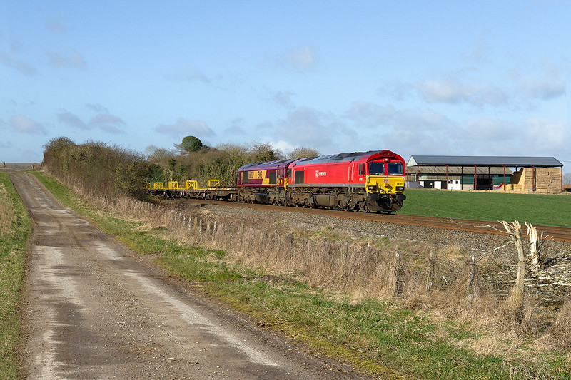 27th Feb 2015:  Double Stamps on 6O41 the morning Departmental from Westbury to Eastleigh is a real bonus.  66101 & 66037 are pictured passing the farm buildings in Watermeadow Lane in Bapton