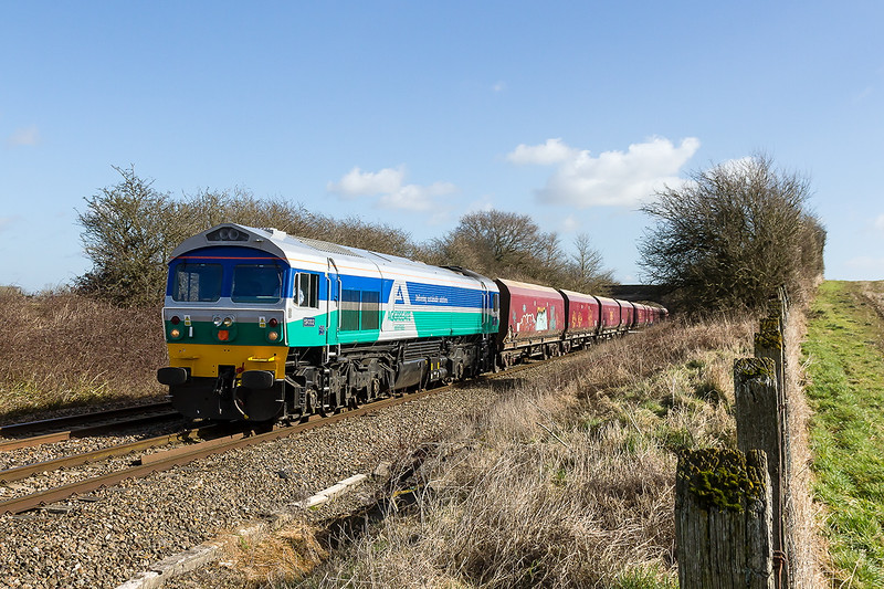 27th Feb 2015:  Still looking pristine after it's recent repaint 59002 'Alan J Day' brings 6C31 from Theale to Merehead forward through Fairwood.