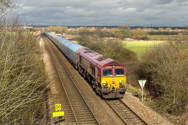 28th Feb 2015:  In a completely un expected patch of sun the diverted 4O40 Cowley to Southampton Eastern Docks Car Carrier powered by 66084 is captured at Heywood