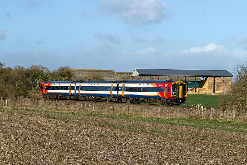 27th Feb 2015:  SWT unit 159005 is working 1O32 the 08.51 Bristol Temple Meads to Waterloo past the farm buildings on Watermeadow Lane in Bapton