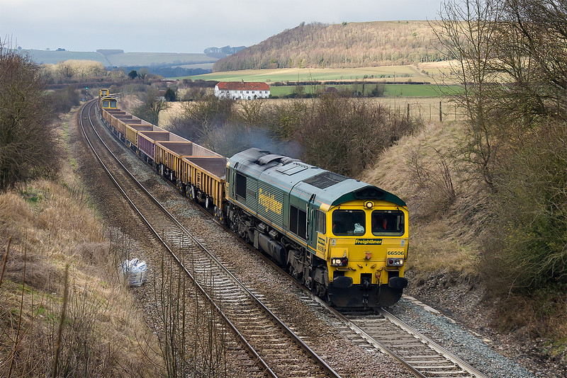 7th Feb 2015:  With sun anoyingly on the distant Battlesbury Hill and not where I was  66506 'Crewe Regeneration' trundles through Norton Bavant with the diverted 6O26 departmental from Hinksey to Eastleigh