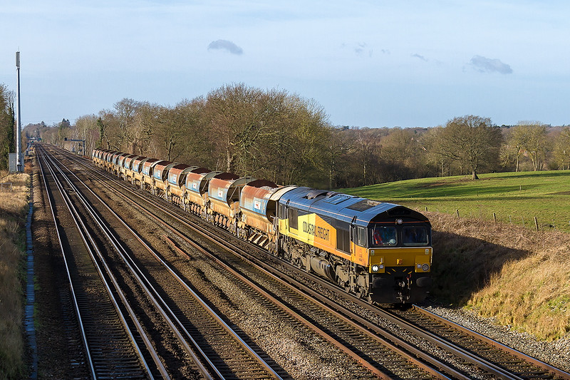 24th Jan 2015:  Colas shed 66846 potters up the slow line between Hook and Wichfield.  6C12 started in Eastleigh and will reverse at Woking and travel via Salisbury to Westbury  where it will reverse again  and go to Yeovil Pen Mill