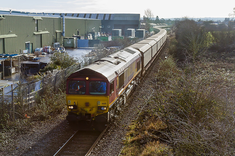 17th Jan 2015:  Diverted due to  engineering work at Reading is 66115 returning to Halewood from Southampton Eastern Docks.  The location is Dunch Lane in Melksham