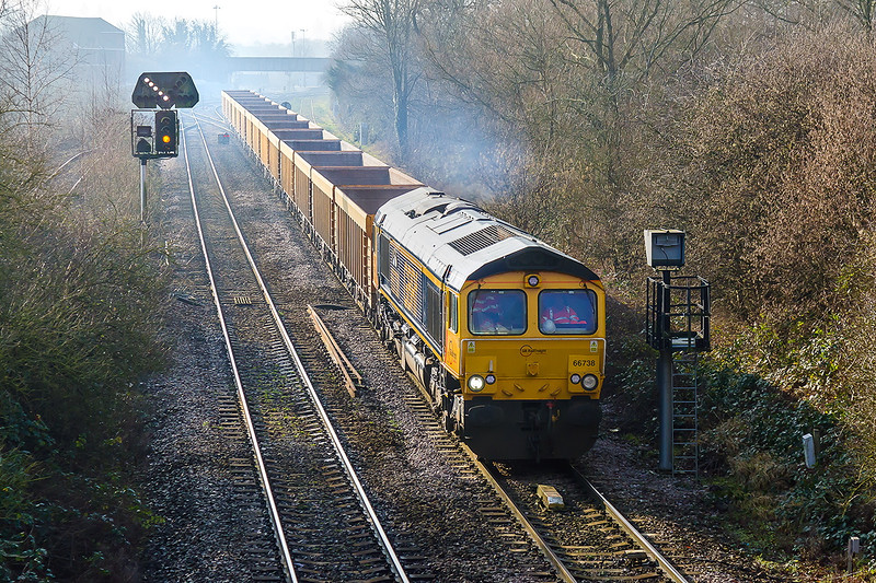 22nd Jan 2015:  With this week's power, 66738, on the front 6M40 nears Hawkeridge Junction whiile working to Stud Farm from Westbury.  The signal is set for the next train  to enter into Platform 1