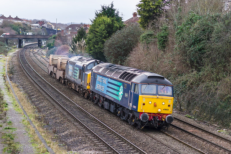 7th Jan 2015;  Running in a slightly later path is 6M63 taking flasks from Bridgewater to Crewe.  Today headed by 47853 and 37612 the train is pictured at Parson Street in Bristol.  47853 (D1733) is famous for being the first loco to be painted in what was to become the standard  'Rail Blue'