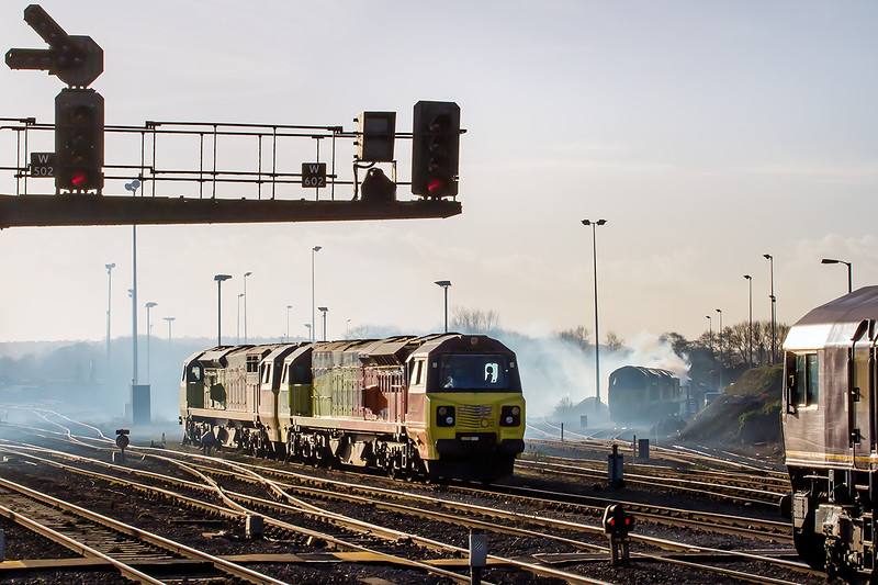 2nd Jan 2015:  An Up Yard  7 loco fest at Westbury.  4 x Colas 70s , nearest are 805 & 810,  2 Colas 60s  60076 & 60085 and DBS 66144. The smoke is coming from 60085 as it is started up having been parked there for several days.   There were 6 x 59 not fotographically possible in the Down Yard as well.  The quarries Christmas shut down being the reason that they are all standing idle.
