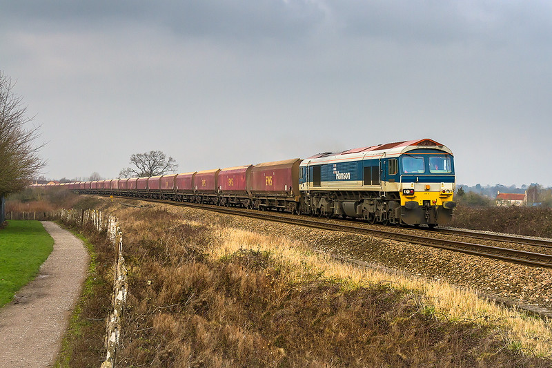 22nd Jan 2015:  Not working via the B & H today  59103, at the helm of 7C31 empties from Theale to Merehead, is pictured at North Bradley behind the White Horse Business Park.  I only bothered with the shot because it features the red coal hoppers which do not usually grace this piece of line