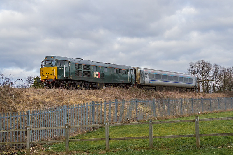 31st Jan 2015:  DCR class 31  31606 with a Chiltern Trains Mainline coach going to Bristol Barton Hill for refurbishment.  5Z35 started from Wembley and is captured near Heywood Road Junction
