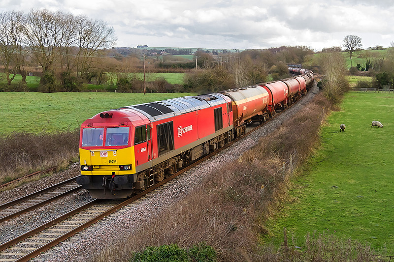 10th Jan 2015:   Cruising down through Great Cheverell  is the diverted 6B33 empty Murco tanks from Theale to Margam with 60054 on the point.  A couple of minutes earlier and it was in full sun