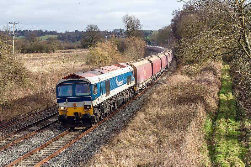 30th Jan 2015:   59103 runs down through Lavington with the EWS HTA coal wagons on 7C31 from Theale to Merehead