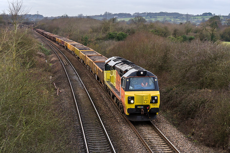 17th Jan 2015:  Now running an hour late and as the light fails 70810 is at Fairwood  on it's return journey from Uphill to Westbury (6C23).  Where did tug 85 gp ?