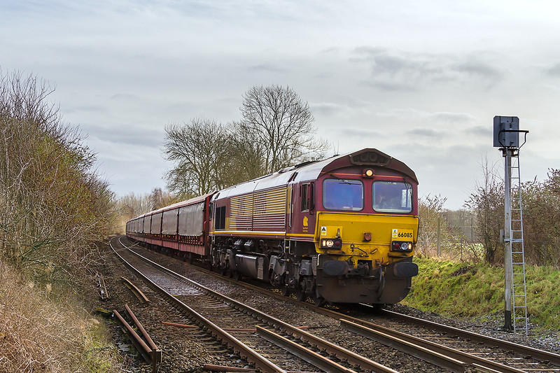 10th Jan 05:  Racing along the Wylye Valley though the site of Codford Station is  66085 and 6M48 from Southampton Eastern Docks to Halewood.  I hope that thas load of Jaguar cars get furthen than the last lot did.