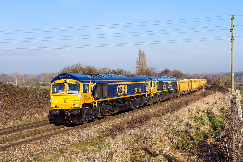 23rd Jan 2015:  66738 failed at Swindon with 6V14 from Stud Farm to Westbury.  66766 was summoned from Eastleigh on a rescue mission.  766 & 738 and the rake of  loaded IOAs are pictured on the approach to Hawkeridge Junction