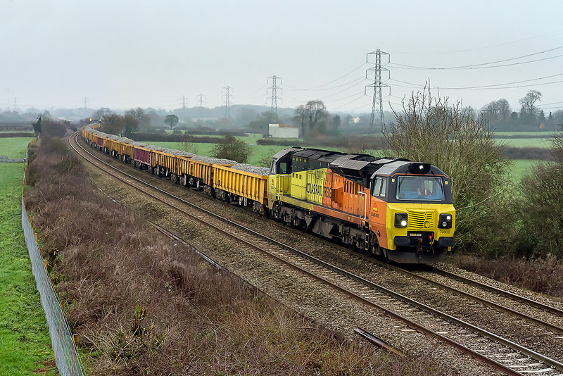 4th Jan 2015:  On a very cold and gray morning 70808 leads on 6C25 from Westbury to Uphill. The long rake of JNAs has 70801 at the tail.