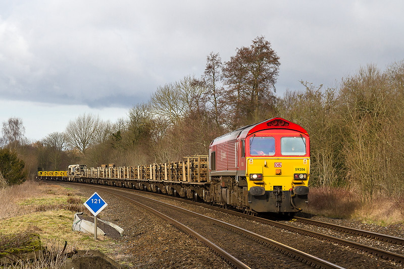 26th Jan 2015:  With a consist of rail carriers 59206 brings the morning Westbury to Eastleigh Departmental (6O41) towards the crossing ar Sherrington Lane in the Wylye Valley