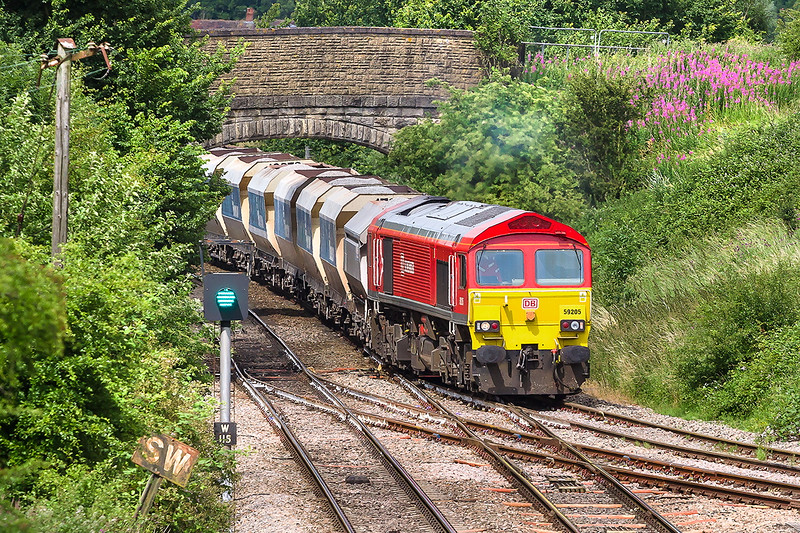 8th Jul 2015:  With the old Great Western 'Sound Whistle' board in the foreground 59205 takes the 73 year old East Chord   at Hawkeridge (it opened in July 1942) to gain the Berks and Hants line.  6A83 is running from Avonmouth Bennets siding to West Drayton