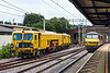 16th Jul 2015:  90048 thunders under the bridge at Marks Tey while working 4M87 from Felixstowe to Trafford Park.  Network Rail Tamper DR 73117 is running back into the S & T siding