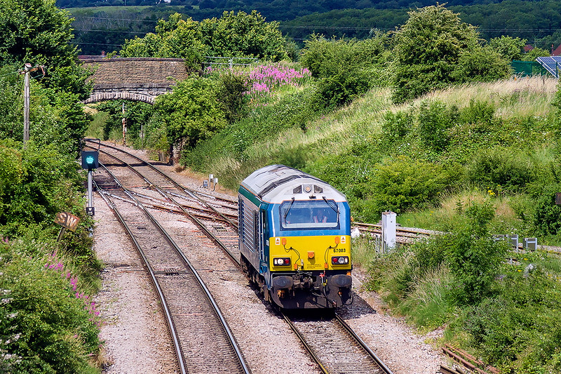 8th Jul 2015:  Having worked to Westbury  from Avonmouth earlier in the day 67003 then worked to Bathampton Junction where it reversed and travelled tp Swiindon.  There it changed direction again to return to Westbury via Melksham.  Captured here as it crosses Hawkeridge Junction with the beautifully named Shallow Wagon Lane bridge in the background
