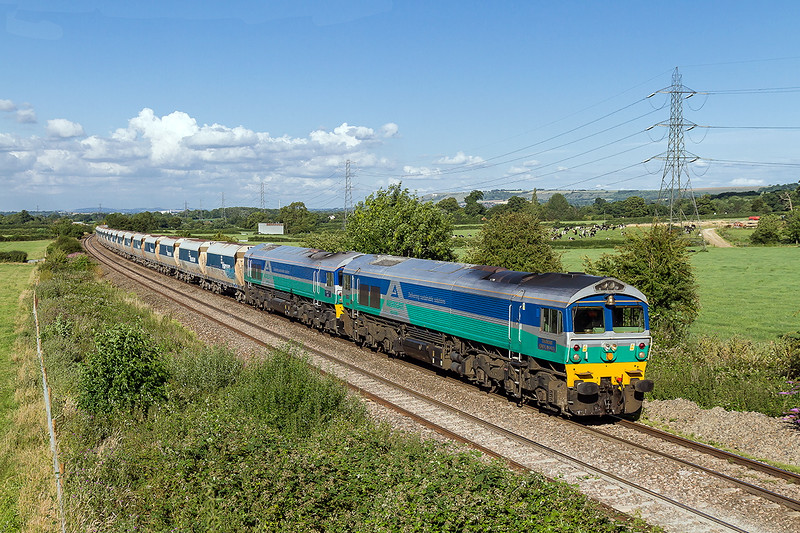 22nd Jul 2015:  The pioneer Yeoman pair  59001  'Yeoman Endevour' and 59002 'Alan J Day' are bringing yet another rake of empties back to the Somerset Quarries for a refill.  It is hard to realise that these two beauties will have been in traffie for 30 years in February 2016.  What must be one of the best investements ever.