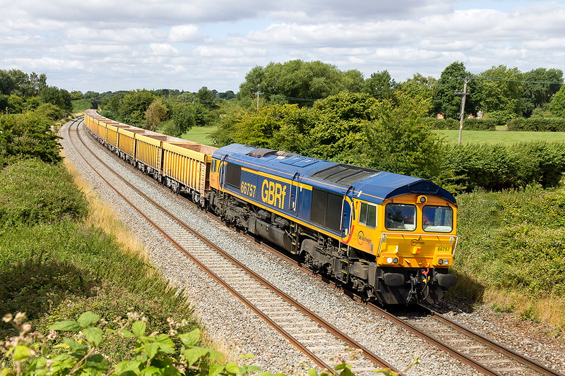 30th Jul 2015:  Diverted onto the Berks & Hants line because of the Box Tunnel Electrification worrks is 66757 and 6M40 from Westbury to Stud Farm.  Pictured here as it nears the site of Lavington Station, which incidentally was in the hamlet of Littleton Pannel