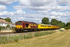 30th Jul 2015:  Captured at Townsend Crossing in Wylye 67008 TnT 67023 are working 1Q23 from Salisbury to Old Oak Common via Basingstoke and Reading.  This journey also involved a trip to Southampton and Westbury