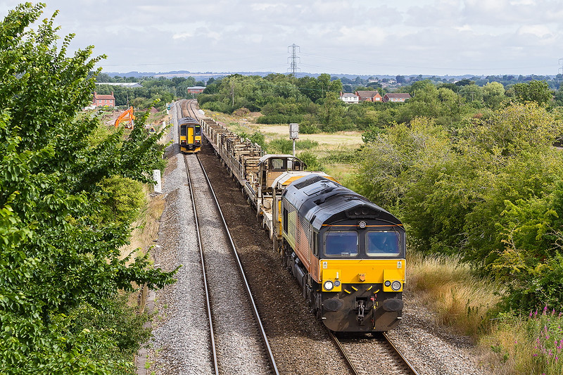 28th Jul 2015:  Colas 66846 is at Heywood after a  rail drop trip to Lostwlthiel.   6C98 is booked to end at Westbury but I suspect that the locot will head the evening Departmental from Westbury to Eastleigh with the JZA's as part of the consist.  In the distance is 153305 working 2M97-08.23 Southampton to Great Malvern.<br /> <br /> I as right about the JZA's but the power was 70810.