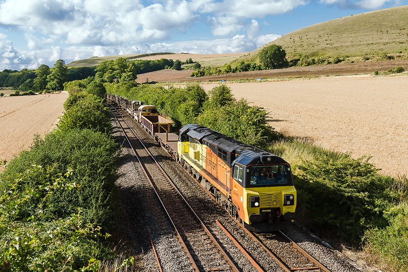 28th Jul 2015:  With a couple of opens and the rake of rail carriers that went to Lostwithiel overnight in tow 70810 is tasked with taking 6O31 from Westbury to Eastleigh.  Captured here nearing Heytsbury
