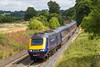 30th Jul 2015:  43147 is running 4 minutes late as it hurries down the grade through Lavington with 1C79 the 11.06 to Plymouth
