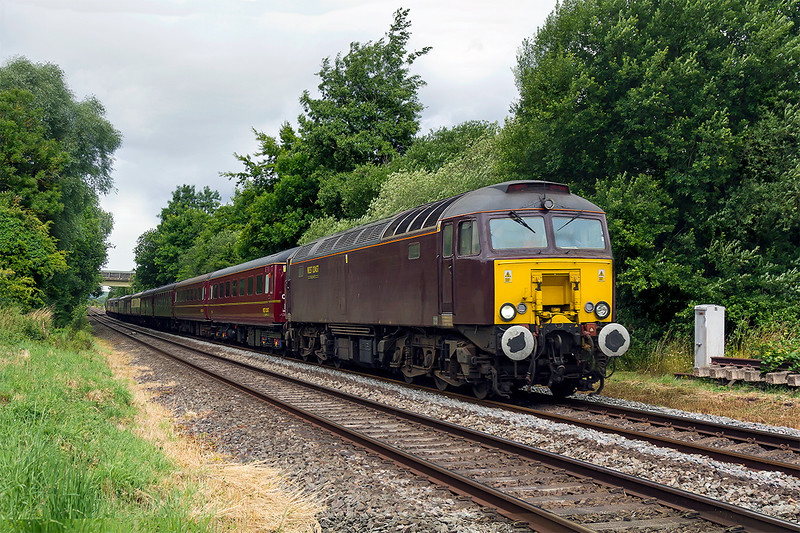 6th Jul 2015:  57313 TnT 57314 are captured passing through the village of Wylye when working to Saltburn from Weston Super Mare