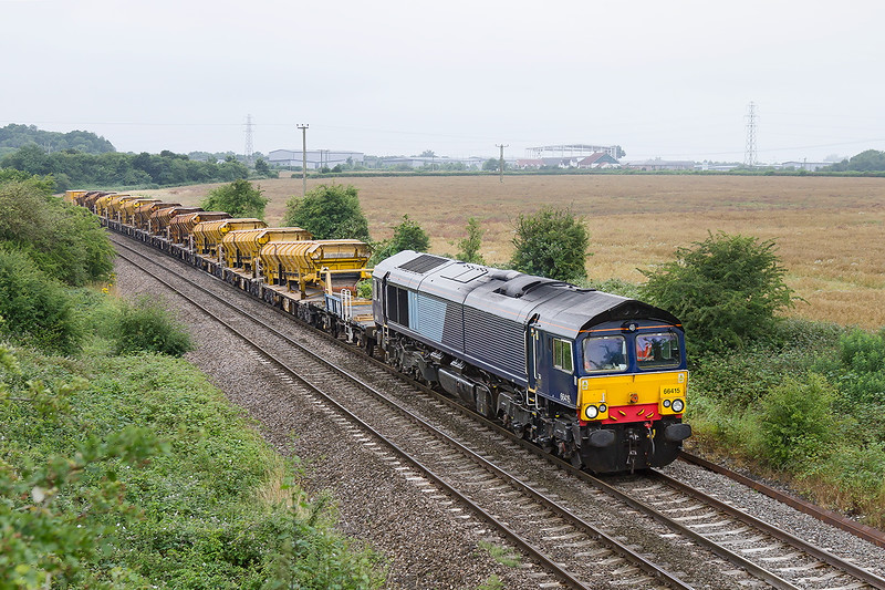 15th Jul 2015:  On another damp morning ex DRS loco 66415 now in the Freightliner fleet is seen at Berkley.  6C84 is bringing empty HOBC wagons from Fairwater Yard in Taunton to Westbury where they will be refilled
