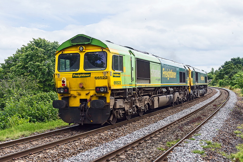 14th Jul 2015:  Having  worked from Maidenhead to Westbury via the B & H  66522 & 66559 travelled to Stoke Gifford.  Pictured here at Dilton Marsh they are now heading for Eastleigh.  They were running about 1 minute late and therefore missed the sun.