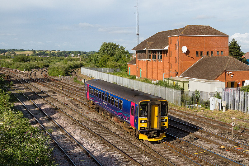 28th Jun 2015: Passing Westbury Panel Signal; Box is 153382 working as 2M14 the 17.45 Chippenham to Westbury.  The Swindon to Chippenham line being closed has forced the revised service