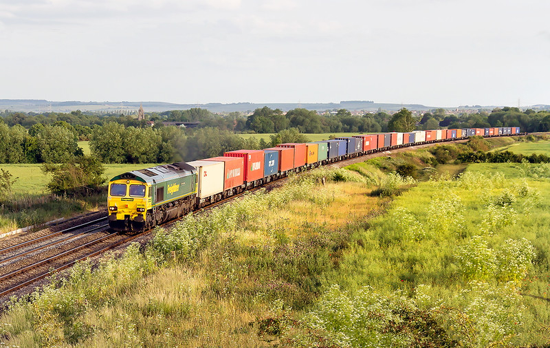 18th Jun 2015:  As the sun drops lower 66532 charges north with 4M97 to Hams Hall from Southampton.  A power line has been cloned from the sky
